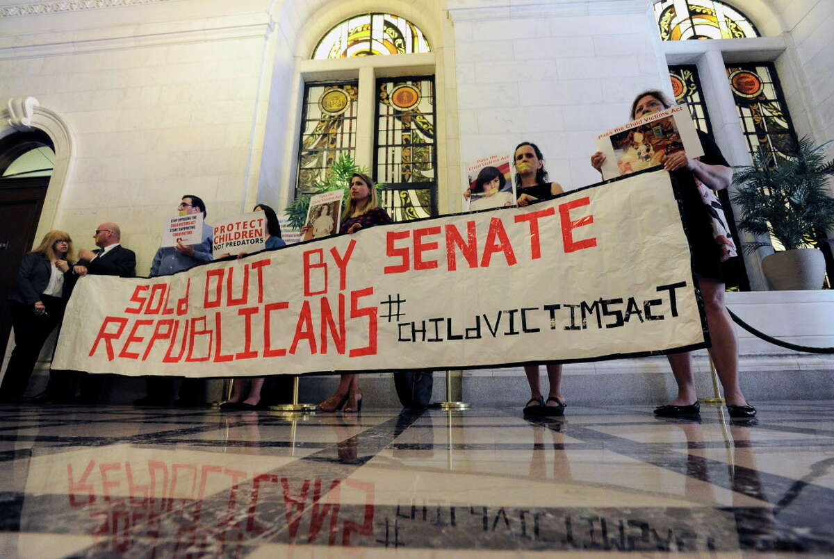 Members of a coalition from across the state urge legislative members to pass the Child Victims Act legislation at the state Capitol during the last day of the legislative session on Wednesday, June 21, 2017, in Albany, N.Y. (AP Photo/Hans Pennink) ORG XMIT: NYHP102