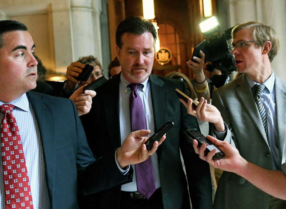 Senate Majority Leader John Flanagan, R-Smithtown, center, speaks with reporters after meeting with New York Gov. Andrew Cuomo at the state Capitol on Tuesday, June 20, 2017, in Albany, N.Y. (AP Photo/Hans Pennink) ORG XMIT: NYHP115 Photo: Hans Pennink / Hans Pennink