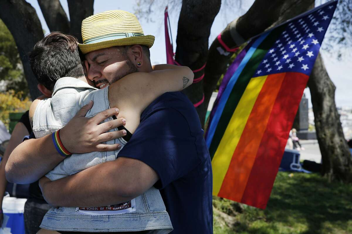 From right: Jimmy Joe embraces Autumn Bailey during the 25th annual Dyke March at Dolores Park on Saturday, June 24, 2017, in San Francisco, Calif.