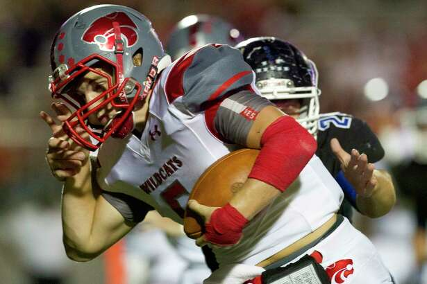 Splendora tailback Evan Nichols (5) tries to run past New Caney defensive back Sam Jones (24) during the first quarter of a District 21-5A high school football game Thursday, Sept. 29, 2016, in Porter.