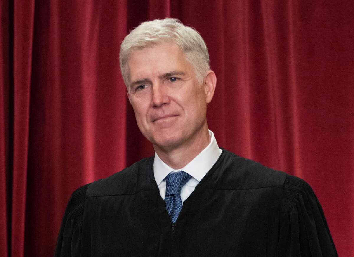 FILE - In this June 1, 2017, file photo Supreme Court Associate Justice Neil Gorsuch is seen during an official group portrait at the Supreme Court Building Washington. For those wondering where Gorsuch will fit on the Supreme CourtÂ?'s ideological spectrum, the best early clue might be to watch the company he keeps. Gorsuch has already paired up four times with Justice Clarence Thomas _ the courtÂ?'s most conservative member _ in separate opinions that dissent from or take issue with the courtÂ?'s majority rulings. (AP Photo/J. Scott Applewhite, File)