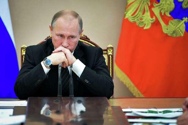 Russian President Vladimir Putin meets with the Cabinet in Moscow, Russia, Thursday, June 22, 2017. (Alexei Druzhinin/Sputnik, Kremlin Pool Photo via AP) ORG XMIT: MOSB118