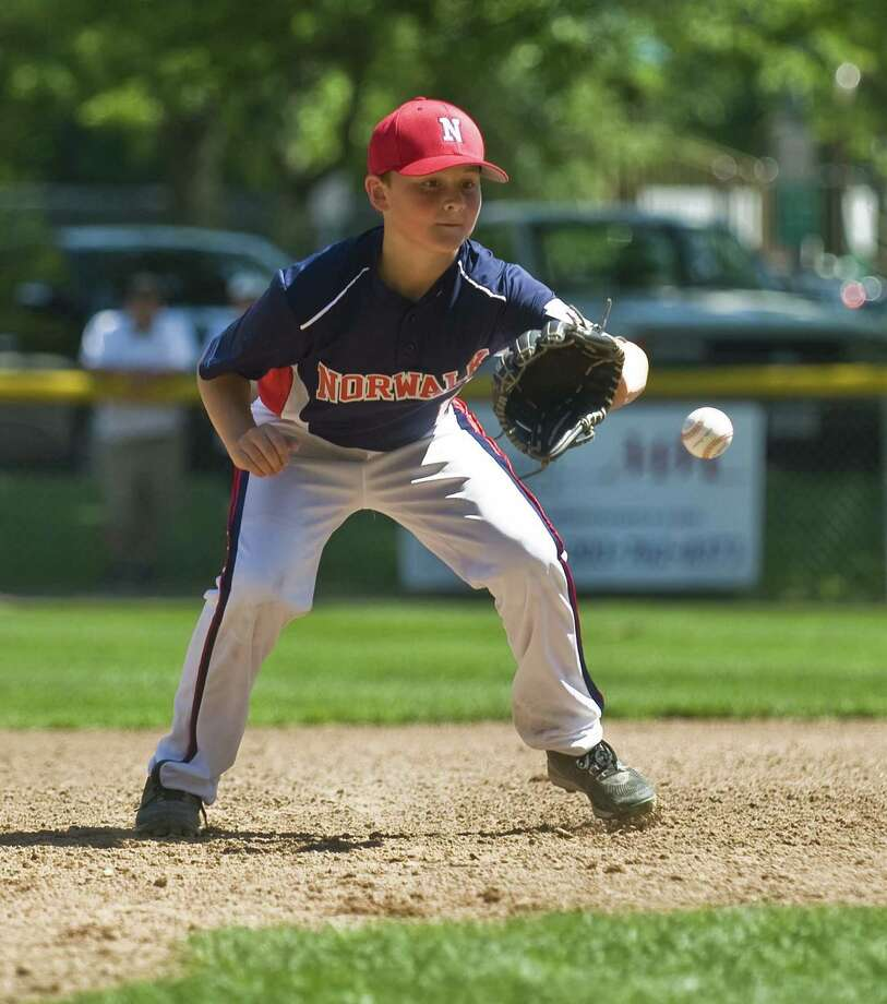 Norwalk's Jake Luthy gets in front of a ground ball at Third in the District 1, 12-year-old Little League All-Star game against Wilton, on Bill Terry Field at the Wilton YMCA. Saturday, June 24, 2017 Photo: Scott Mullin / Scott Mullin / The News-Times Freelance