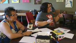 Instructors Patricia Castillo (left) and Lisa Knecht talk about Mexican-American lore with South San Antonio Independent School District students at Barrio Barista earlier this month. The MAS for the Masses two-week workshop aims to teach Mexican-American students about their history and culture.