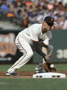 San Francisco Giants third baseman Ryder Jones fields a double play ground ball hit into by New York Mets' Travis d'Arnaud during the second inning of a baseball game in San Francisco, Saturday, June 24, 2017. (AP Photo/Jeff Chiu)