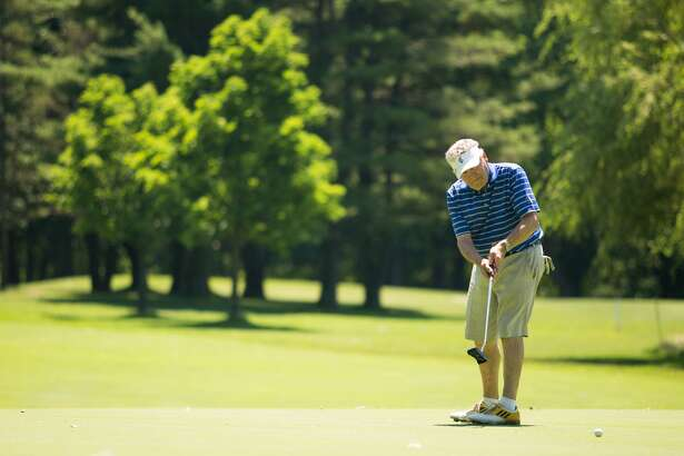 Hub Orr watches his putt during the Town Tournament at the Griffith E. Harris Golf Club in Greenwich, Conn. on Saturday, June 24, 2017.
