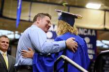 Brookfield High School teacher John LaMendola is privileged to take the platform and hand his daughter Samantha LaMendola her diploma during their Commencement Exercises that took place on Saturday June 24, 2017 at Western Connecticut State University.