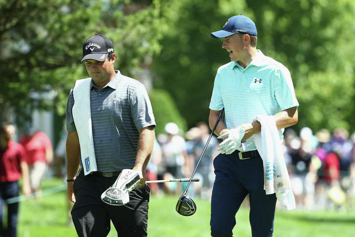 Patrick Reed and Jordan Spieth walk to the sixth tee during the third round of the Travelers Championship at TPC River Highlands on Saturday in Cromwell.