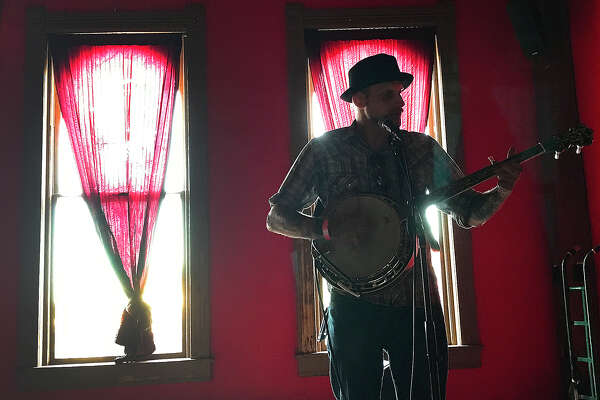 Jacob McGreevy takes the stage at the inaugural Our Tyme Music Fest at the Red Room Lounge on Crockett Street Saturday. The event featured 11 area folk artists and is slated to be an annual addition to the city's summer music festivals. Photo taken Saturday, June 24, 2017 Kim Brent/The Enterprise
