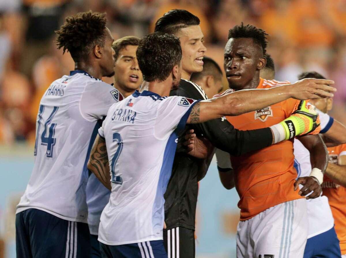 The Dynamo-FC Dallas rivalry is always good for a squabble. Here, FC Dallas goalie Jesse Gonzalez separates Dynamo forward Alberth Elis, right, and FC Dallas defender Hernan Grana.