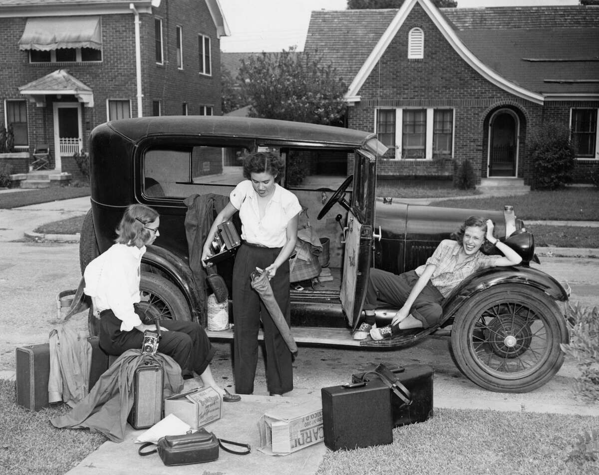 Jeanne Billfaldt, left, Caroline Valenta and Patye Billfaldt outside Valenta's Model A in the Third Ward, 1947.