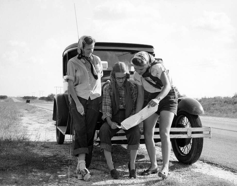 Patye Billfaldt, left, Jeanne Billfaldt and Caroline Valenta outside Valenta's Model A somewhere in northern Mexico, 1947. Note apparent shutter cord running from the passenger side of the vehicle to the camera. Photo: Courtesy J.R. Gonzales