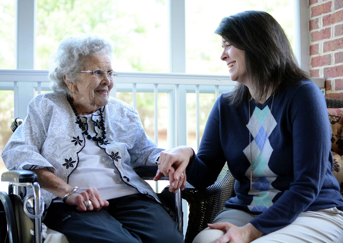 Kim Bartley, right, visits with Alice Jacobs, 90, at Dogwood Village, a nonprofit county-owned nursing home in Orange, Va. Medicaid pays for most of the 1.4 million elderly people in nursing homes.