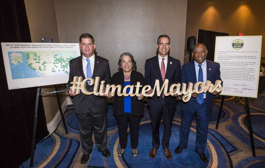 Mayor Eric Garcetti of Los Angeles andMayor Sylvester Turner of Houston (the two on the right) are acquainted through their work with the Climate Mayors group.