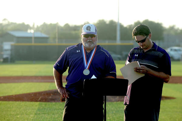 Port Neches - Groves' head coach Scott Carter prepares the podium as the pep rally gets underway following the parade celebrating the baseball team's 5A state championship victory Friday. The parade made its way through town, ending at the baseball stadium, where a pep rally was held. Photo taken Friday, June 23, 2017 Kim Brent/The Enterprise