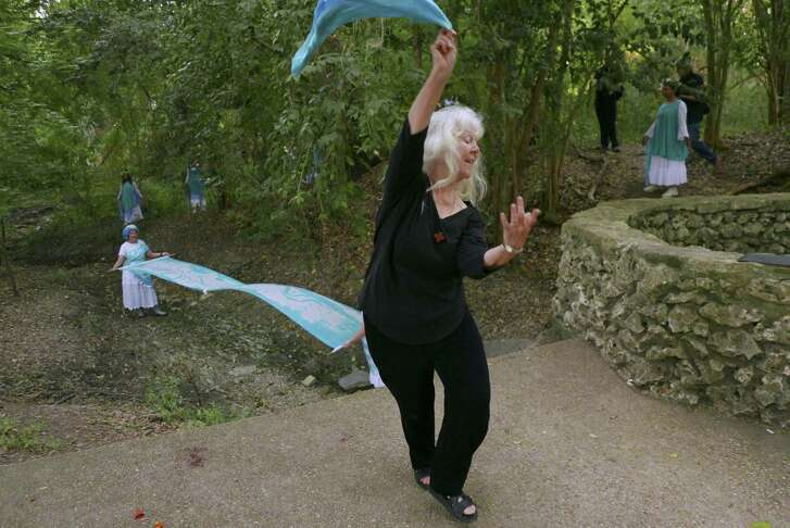 Sister Martha Ann Kirk, chair of the Incarnate Word Sisters' Justice, Peace and Integrity of Creation Committee, performs a water dance by the Blue Hole.