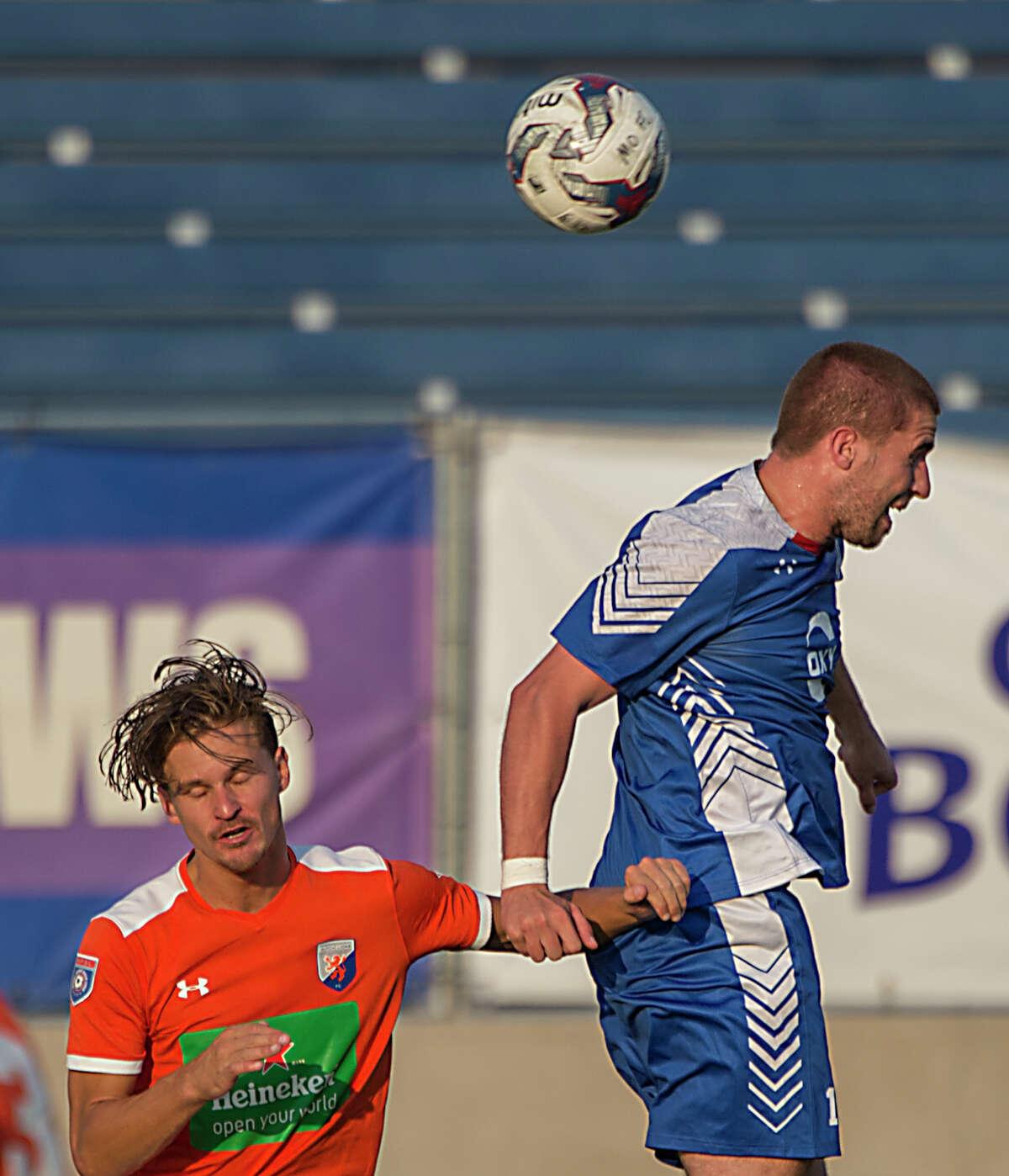 Midland Odessa FC's Jamie O'Grady gets up over Dutch Lions FC's Felix Verhaar for the ball 6/24/17 at Grande Communications Stadium. Tim Fischer/Reporter-Telegram