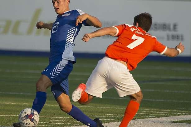 Midland Odessa FC's Elliott Bentley knocks the ball away from Dutch Lions FC's Pablo Corvarrubias 6/24/17 at Grande Communications Stadium. Tim Fischer/Reporter-Telegram
