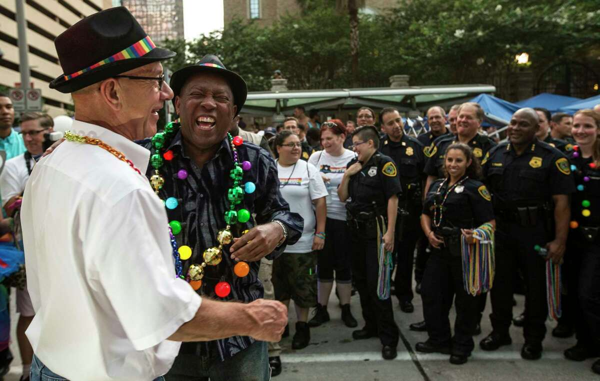 Houston Mayor Syvester Turner laughs with Sen. John Whitmire during the annual Pride Parade on Saturday, June 24, 2017, in Houston.