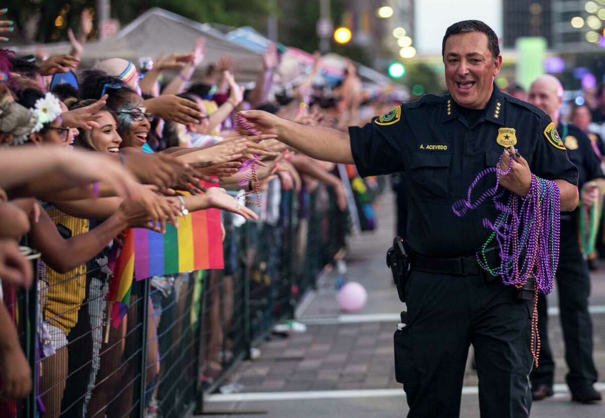 Houston Police Chief Art Acevedo hands out beads as he marches in the annual Pride Parade on Saturday, June 24, 2017, in Houston.
