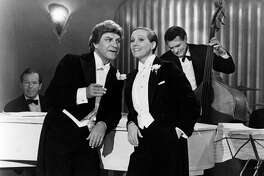 American actor Robert Preston and British actress Julie Andrews (Julia Elizabeth Wells) singing in the film Victor/Victoria. USA, 1982 (Photo by Mondadori Portfolio via Getty Images)