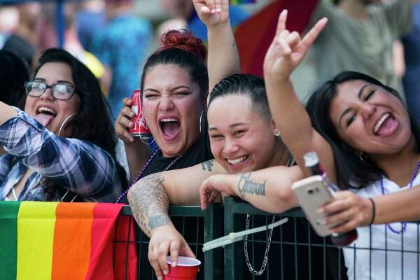 Parade goers cheer as they watch the annual Pride Parade on Saturday, June 24, 2017, in Houston.