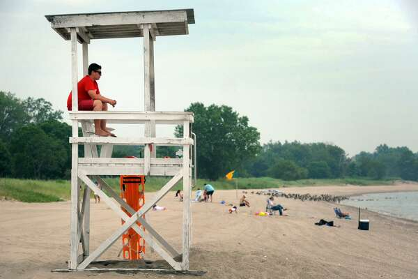 Lifeguard Dan Murphy watches the beach on a quiet afternoon at Sherwood Island State Park, in Westport, Conn. June 23, 2017.