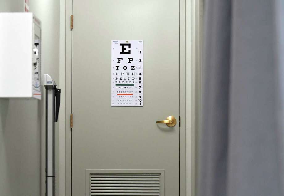 Eye chart and scales in the Mont Pleasant Middle School Hometown Health Centers clinic lab on Friday, June 9, 2017, in Schenectady, N.Y. (Will Waldron/Times Union) Photo: Will Waldron / 40040735A