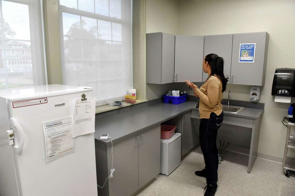 Ashley Gee, family nurse practitioner and program manager for the Hometown Health Centers clinic at Mont Pleasant Middle School, stands in the clinic?'s lab on Friday, June 9, 2017, in Schenectady, N.Y. (Will Waldron/Times Union)
