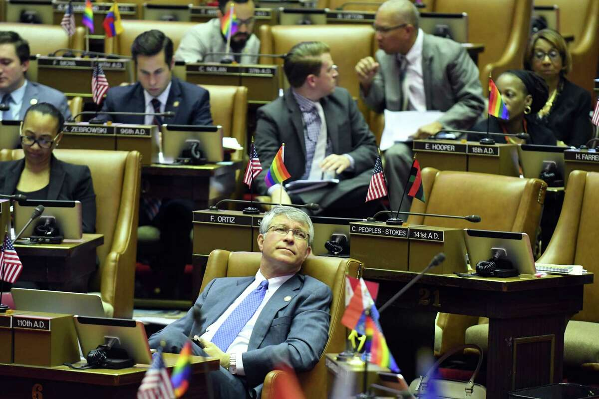 Assemblyman Phil Steck looks up at the vote tally board during session in the Assembly on Wednesday, June 21, 2017, at the Capitol in Albany, N.Y. (Will Waldron/Times Union)