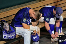 TCU's Cam Warner, left, reacts with the TCU dugout after losing to Florida in an NCAA College World Series baseball elimination game in Omaha, Neb., Saturday, June 24, 2017. (AP Photo/Nati Harnik)