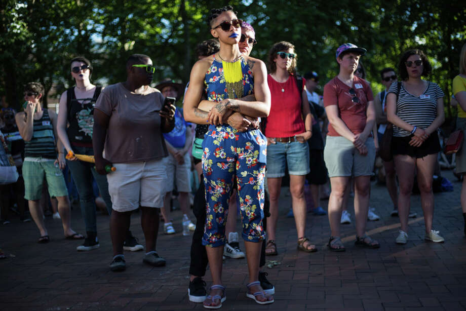 Barbara Jefferson and Sonj Basha listen to speakers before the Dyke March during PrideFest Capitol Hill on Saturday, June 24, 2017. Photo: GRANT HINDSLEY, SEATTLEPI.COM / SEATTLEPI.COM