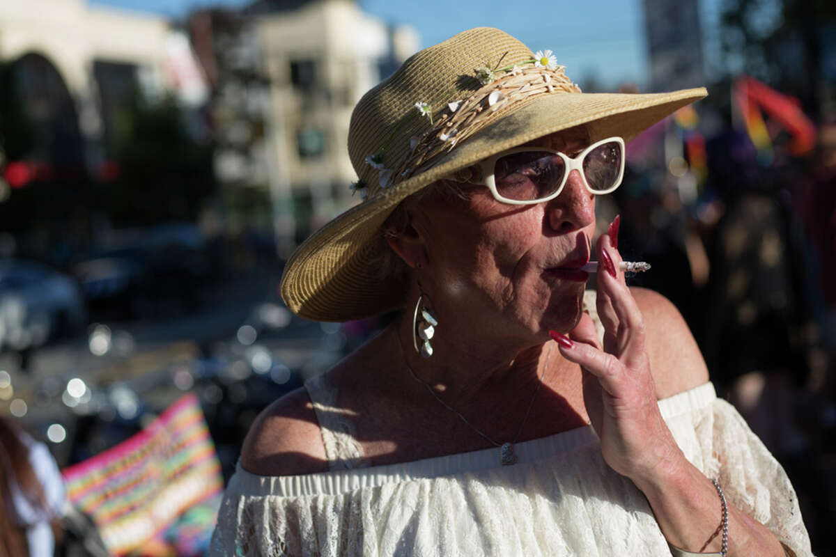 Susanne Gamber, 62, smokes a cigarette before the Dyke March during PrideFest Capitol Hill on Saturday, June 24, 2017. Gamber, an Air Force veteran transitioned two and half years ago, and is healthier and happier than she's ever been.