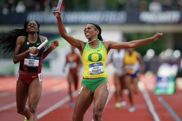 Oregon's Raevyn Rogers celebrates as she crosses the finish line ahead of Southern California's Kendall Ellis to win the women's 4x400 meters relay on the final day of the NCAA outdoor college track and field championships in Eugene, Ore., Saturday, June 10, 2017. (AP Photo/Timothy J. Gonzalez)