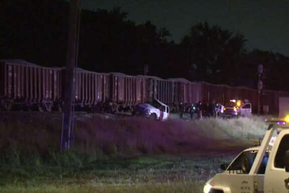 One person died after his truck was hit by a train.