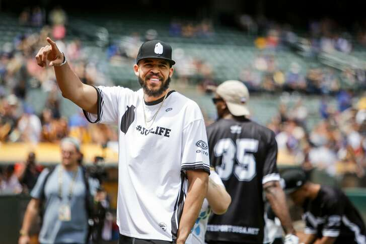 Javale McGee waves to fans during the Juglife Javale McGee Celebrity Softball Game in the Oakland-Alameda County Coliseum in Oakland on Saturday, June 24, 2017.