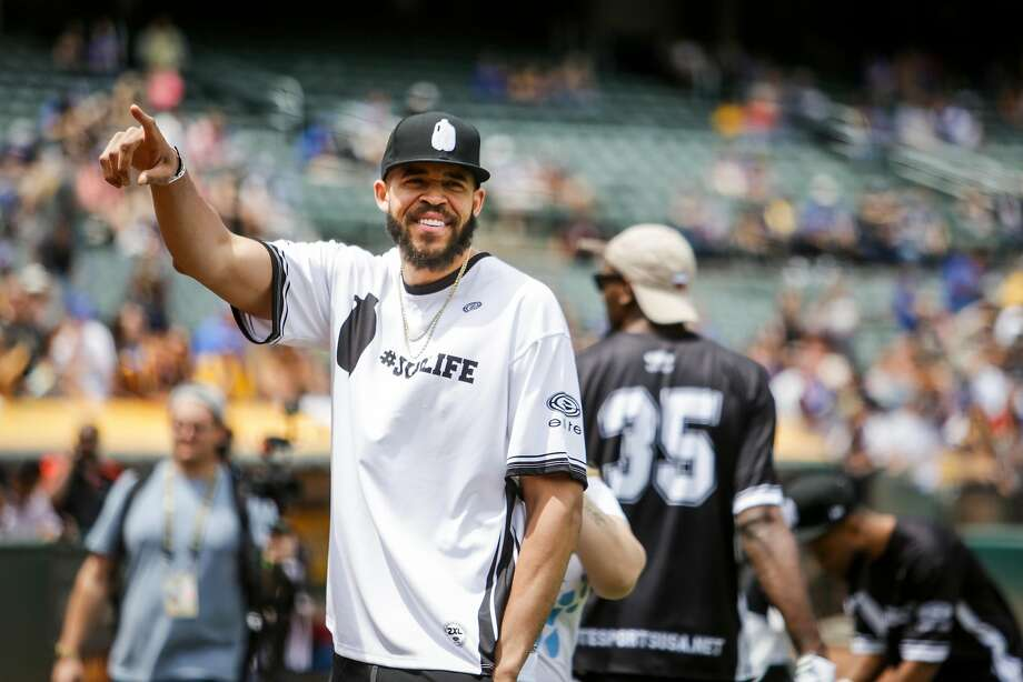 Javale McGee waves to fans during the Juglife Javale McGee Celebrity Softball Game in the Oakland-Alameda County Coliseum in Oakland on Saturday, June 24, 2017. Photo: Nicole Boliaux, The Chronicle