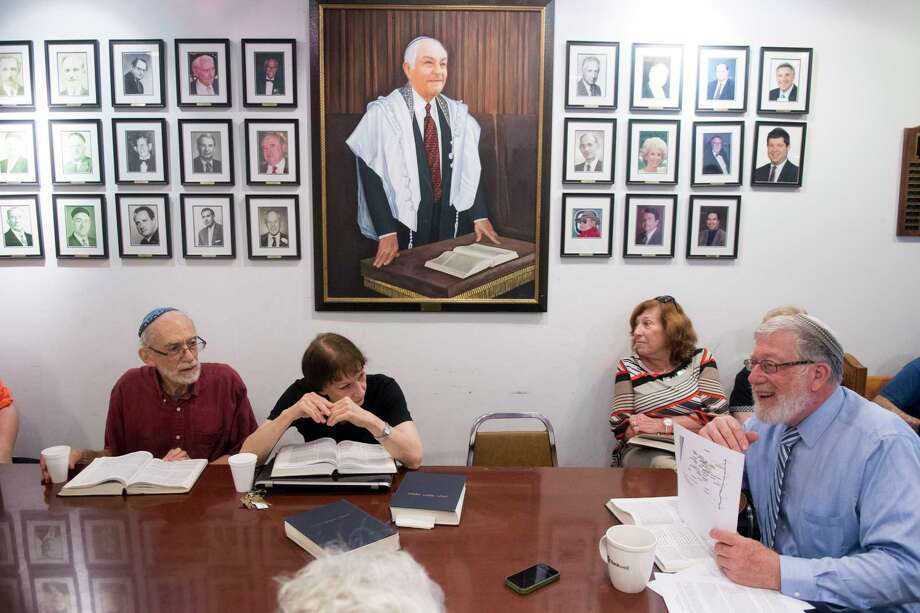 Rabbi David Walk, the educator in residence at Temple Agudath Sholom, teaches his final Bible/Torah study class at the Temple on Strawberry Hill Avenue, in Stamford, Conn., on Sunday, June 25, 2017. After completing 16 years as assistant rabbi and educator in residence at the Newfield synagogue, Walk is returning to Israel on Monday. Walk teaches under the gaze of the synagogue's past presidents whose portraits line the wall, and Rabbi Emeritus Joseph Ehrenkrantz, whose portrait is most prominent and who was a mentor for Walk and others during the course of his 50 years at Agudath Sholom. Photo: Keelin Daly, For Hearst Connecticut Media / Stamford Advocate freelance