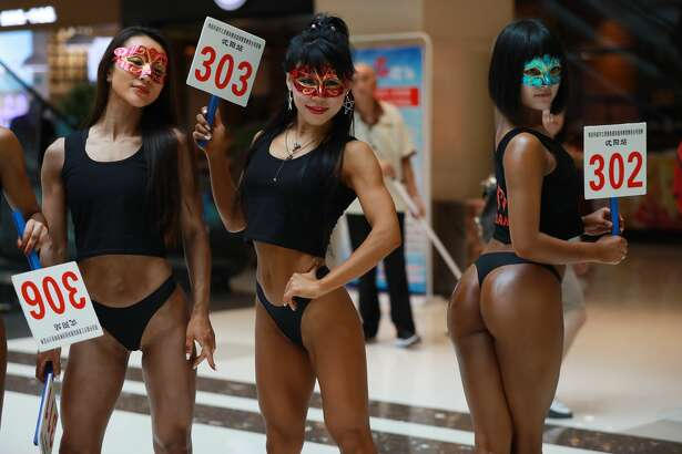 """In this picture taken on June 24, 2017 participants take part in the """"Women's Beautiful Buttock series"""" contest shopping mall in Shenyang, Liaoning province. / AFP PHOTO / STR / China OUT        (Photo credit should read STR/AFP/Getty Images)"""