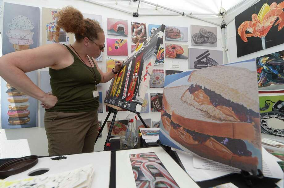 Andrea Nally paints in her booth as over 100 artists show one-of-a-kind ceramics, wearable art and a wide variety of other fine arts and crafts at the 5th Annual Norwalk Art Festival Saturday, June 24, 2017 in Mathews Park in Norwalk, Conn. Photo: Erik Trautmann / Hearst Connecticut Media / Norwalk Hour