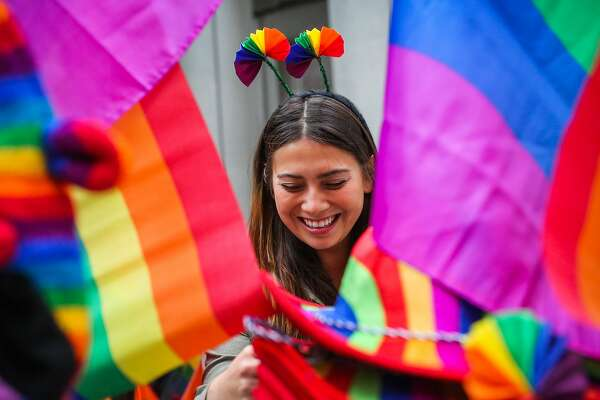Julia Dorosh shops for rainbow gear ahead of the Pride Parade in San Francisco, California, on Sunday, June 25, 2017.