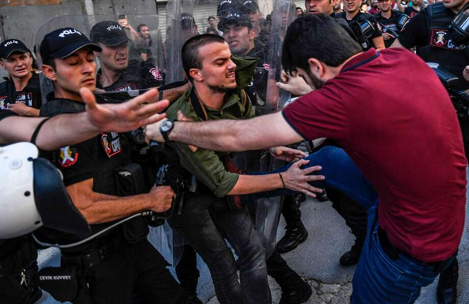 A plainclothes police officer kicks an LGBT rights activist as Turkish police enforce a ban imposed on the Pride Parade in Istanbul. An estimated 20 people were detained. Photo: BULENT KILIC, AFP/Getty Images