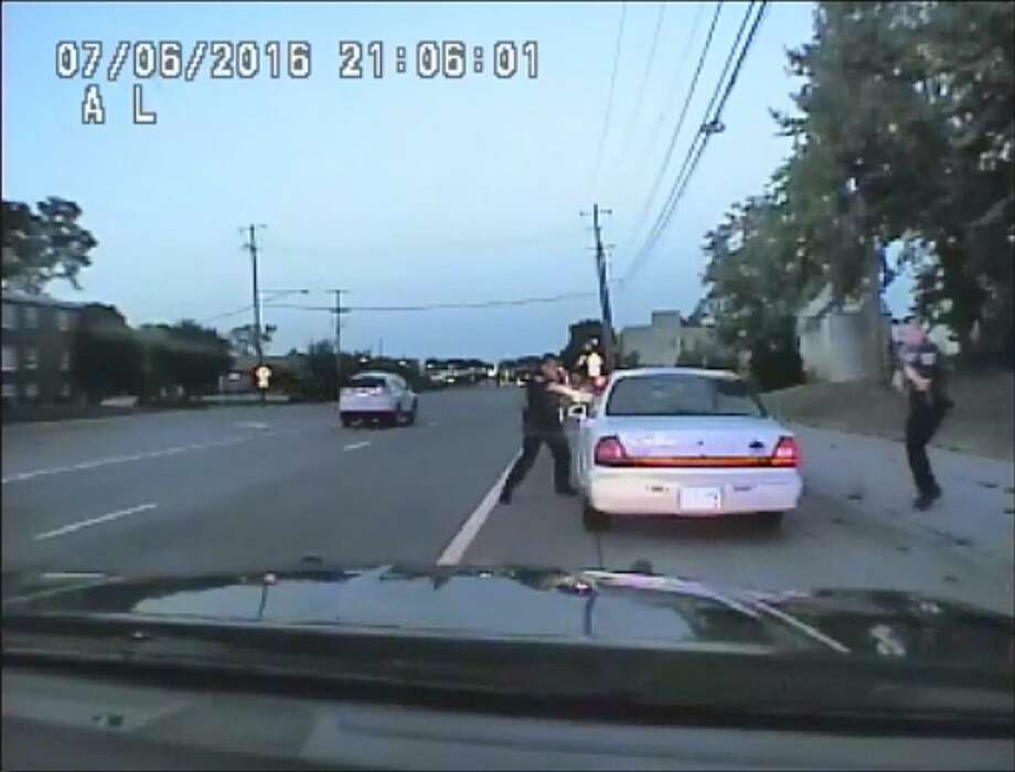 In this image made from July 6, 2016, video captured by a camera in the squad car of St. Anthony Police officer Jeronimo Yanez, the Minnesota police officer shoots at Philando Castile in the vehicle during a traffic stop in Falcon Heights, Minn. Yanez's backup officer Joseph Kauser is seen standing on the passenger side of the vehicle. The video was made public by the Minnesota Bureau of Criminal Apprehension and the Ramsey County Attorney's Office, Tuesday, June 20, 2017, just days after the officer was acquitted on all counts in the case. (St. Anthony Police department via AP) Photo: Associated Press / St. Anthony Police department