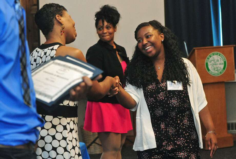 Participants in the Norwalk's 2017 Youth Summer Jobs Program including Nikia Renie graduate from their four day training course Friday, June 23, 2017, during a ceremony in the City Hall Community Room in Norwalk, Conn. Participants will begin their employment through the program at 50 workplaces June 26. Photo: Erik Trautmann / Hearst Connecticut Media / Norwalk Hour