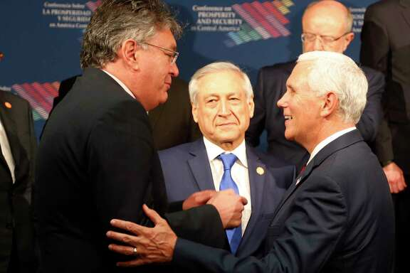 Colombia's Minister of Finance Mauricio Cardenas, left, talks with Vice President Mike Pence, right, during a conference earlier this month on Prosperity and Security in Central America in Miami. (AP Photo/Wilfredo Lee, Pool)
