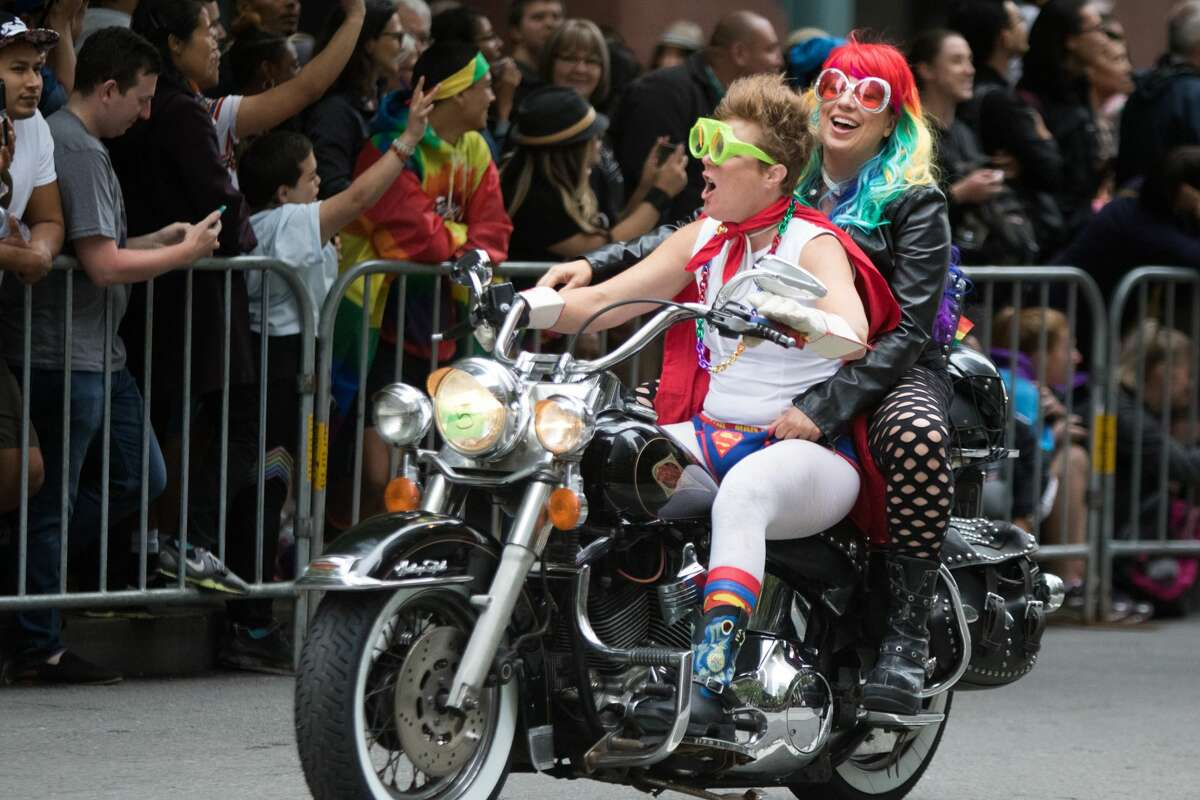 Participants take part in the San Francisco Pride parade in San Francisco on June 25, 2017