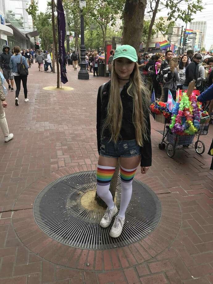Alissa Long, 19, of San Jose wore thigh-high rainbow socks to Sunday's San Francisco Pride parade. Photo: Tony Bravo