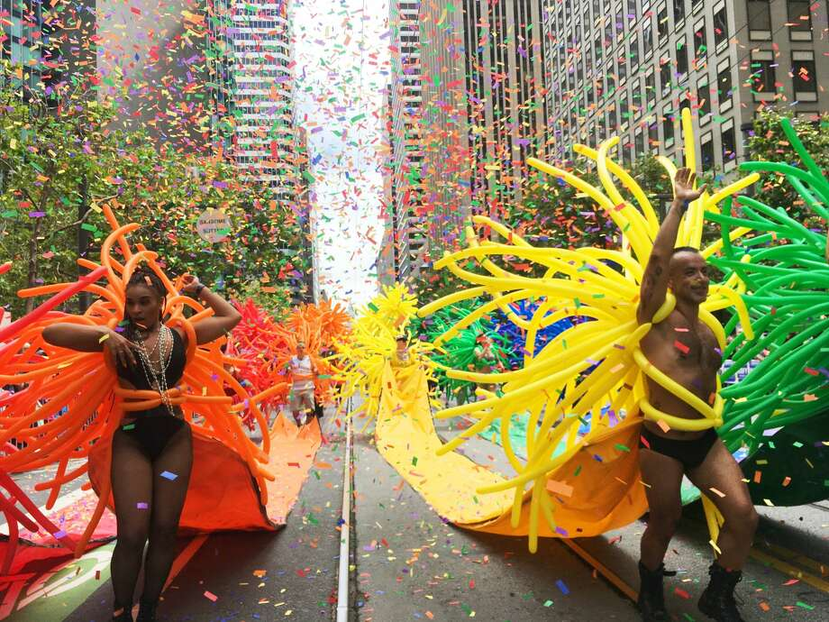 Dancers head down Market Street in a shower of confetti and balloons as they march in the 2017 Pride Parade. Photo: Douglas Zimmerman / SFGate.com