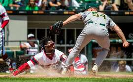 Chicago White Sox second baseman Alen Hanson (39) is tagged out at the plate by Oakland Athletics starting pitcher Sonny Gray (54) in the first inning on Sunday, June 25, 2017 at Guaranteed Rate Field in Chicago, Ill. (Brian Cassella/Chicago Tribune/TNS)