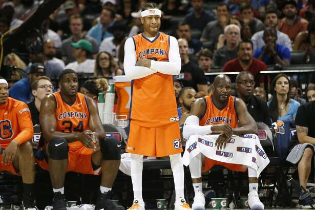 3's Company player/captain and coach Allen Iverson, center, watches from the sideline during the first half of Game 3 against the Ball Hogs in the BIG3 Basketball League debut, Sunday, June 25, 2017, at the Barclays Center in New York. (AP Photo/Kathy Willens)